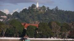 View of lake with Bahiravokanda Vihara statue,Kandy,Sri Lanka Stock Footage