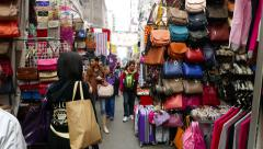 Colorful street market, sides hand with goods and souvenirs Stock Footage