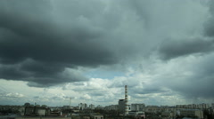 The industrial city landscape with thunderstorm clouds. Fast time lapse Stock Footage