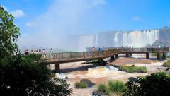 Tourists on the viewpoint in front of the Iguazu Falls in Brazil. Time lapse Stock Footage