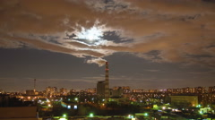 The moon and clouds above night city. Fast time lapse - stock footage