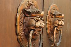 Traditional Chinese old door with lion head knockers,shallow DOF - stock photo