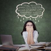 Teenage student looks stressed - stock photo