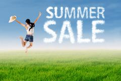 Woman jumps with summer sale cloud Stock Photos