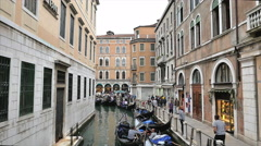 Gondoliers and tourists on a side canal in Venice, Italy-4K Stock Footage