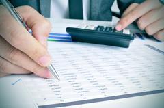 Young businessman checking accounts Stock Photos