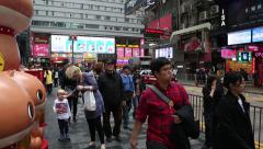 People on the streets in the central district of Kowloon in Hong Kong. - stock footage