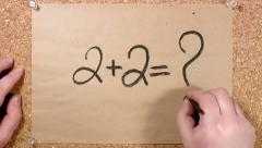 mathematical constant 2+2 written on paper - stock footage