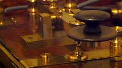 Gold plated weighing scale in a museum Stock Footage