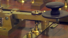 An old model of a weighing scale in a museum - stock footage