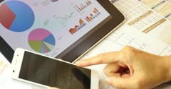 4k Business people browsing financial data on smartPhone & ipad. Stock Footage