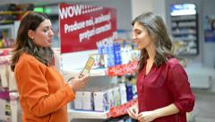 Customer choosing cosmetic products in supermarket Stock Footage