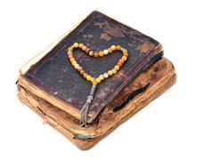 Manuscript Holy Quran and Muslim prayer beads - stock photo