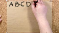 English alphabet written on paper Stock Footage