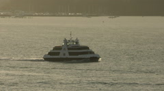 Auckland Ferry entering harbour at dawn Stock Footage
