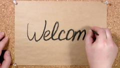 Word Welcome written on paper Stock Footage