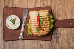 Classic club sandwich with bacon and vegetables Stock Photos