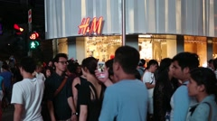People at the H & M store on Orchard Road in Singapore Stock Footage