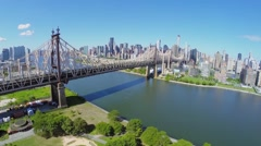 Transport traffic on Queens Bridge over East River at summer Stock Footage