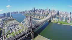 City traffic on Queensbridge over East River at summer Stock Footage