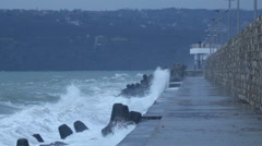 Waves splashing and gale force wind gusts harbor pier Stock Footage
