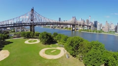 Queensboro Bridge near sports playground in Queensbridge Park Stock Footage