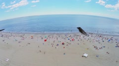Crowd of people get rest on Brighton Beach at summer day Stock Footage