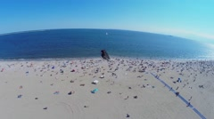 Brighton Beach with lot of people get rest at summer sunny day Stock Footage