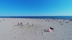 Group of men play soccer on Brighton Beach at summer Stock Footage