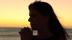 Woman Praying and Talking with Clasped Hands Stock Footage
