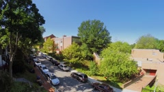 Cars parked on Mt. Pleasant Street NW near Elementary School Stock Footage