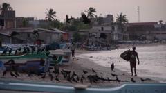 Man with basket on beach,Trincomalee,Sri Lanka Stock Footage