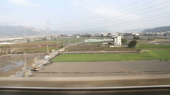 Taiwan Rural Scene Out of The Window of a Driving High-Speed Train. HD - stock footage