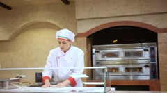 RUSSIA, MOSCOW, 7 MARCH 2015, One chef baker in white uniform with bakery pastry Stock Footage