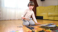 Kid solving a floor puzzle at home Stock Footage