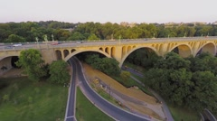 Cars ride by on William Howard Taft Bridge at summer evening Stock Footage