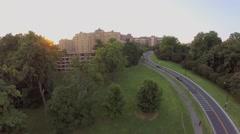 City traffic on Rock Creek Parkway near Omni Shoreham Hotel Stock Footage