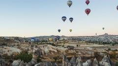 Timelapse of beautiful rocky landscape of Cappadocia with flying colorful Stock Footage