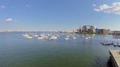 People walk by pier near Boston Harbor Sailing Club Mooring Field Arkistovideo