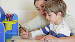 Mother helping her kid to make drawings - stock footage