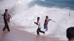 Fisherman fishing with landing net in the waves,Batticaloa,Sri Lanka Stock Footage