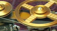 Two gold pulley levers with string - stock footage