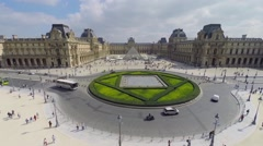 Transport traffic on square Place du Carrousel near museum Stock Footage
