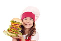 Little girl cook with big hamburger Stock Photos