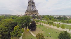 Many people get rest in park Champ de Mars near Eiffel Tower Stock Footage