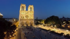 Cathedral Notre Dame de Paris on square with lot of people Stock Footage