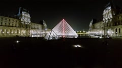 Louvre Pyramid on square near museum in Royal Palace Stock Footage