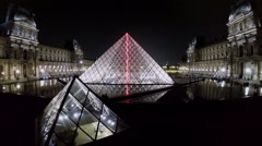 Louvre Pyramid from glass near museum in edifice of Royal Palace Stock Footage