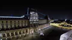 Ray of projector from Eiffel Tower moves above Louvre Museum - stock footage