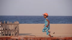 Young girl running at the beach,Batticaloa,Sri Lanka Stock Footage
